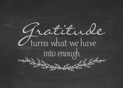 Quote about gratitude on dusty black chalkboard.
